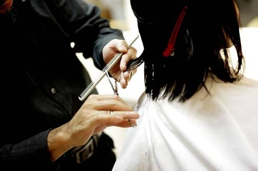 Trim your hair Regularly to Prevent hair fall