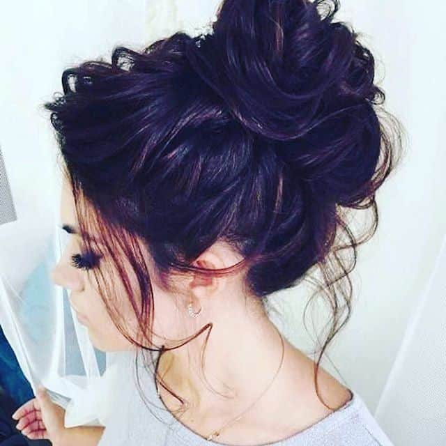 Voluminous Messy Updo with Curls