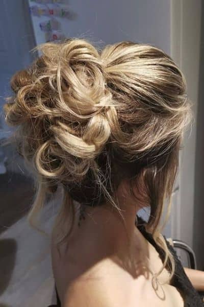 High Messy Bun with Twists and Curls